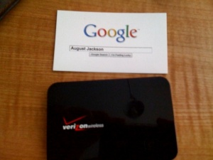 My Verizon Wireless MiFi, next to standard business card for size comparison.